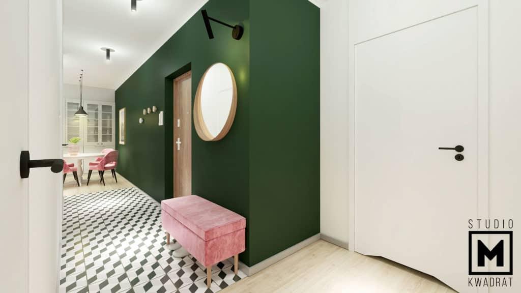 siedzisko w kolorze pudrowego różu, okrągłe lustro przy wejściu do mieszkania, retro płytki na podłodze