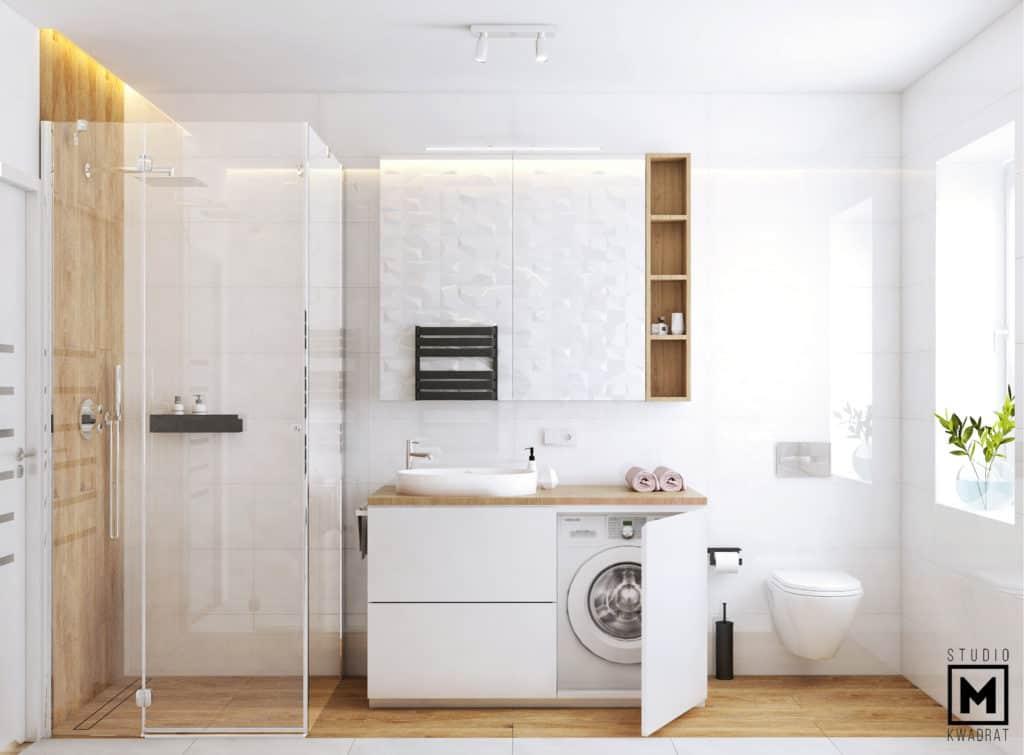 Projekt eleganckiej łazienki, szklana kabina prysznicowa, lustro, pralka ukryta w zabudowie.
