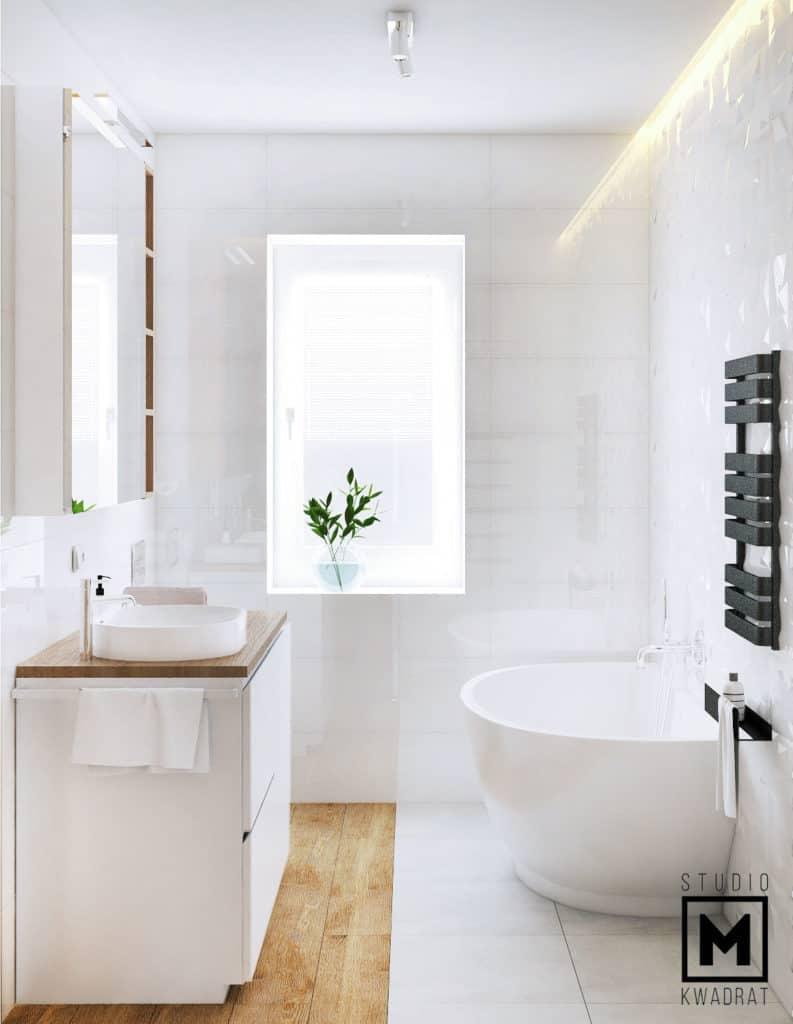 Różna rodzaje płytek w łazience, biała wanna Segea, zabudowa łazienkowa projektowana na wymiar.