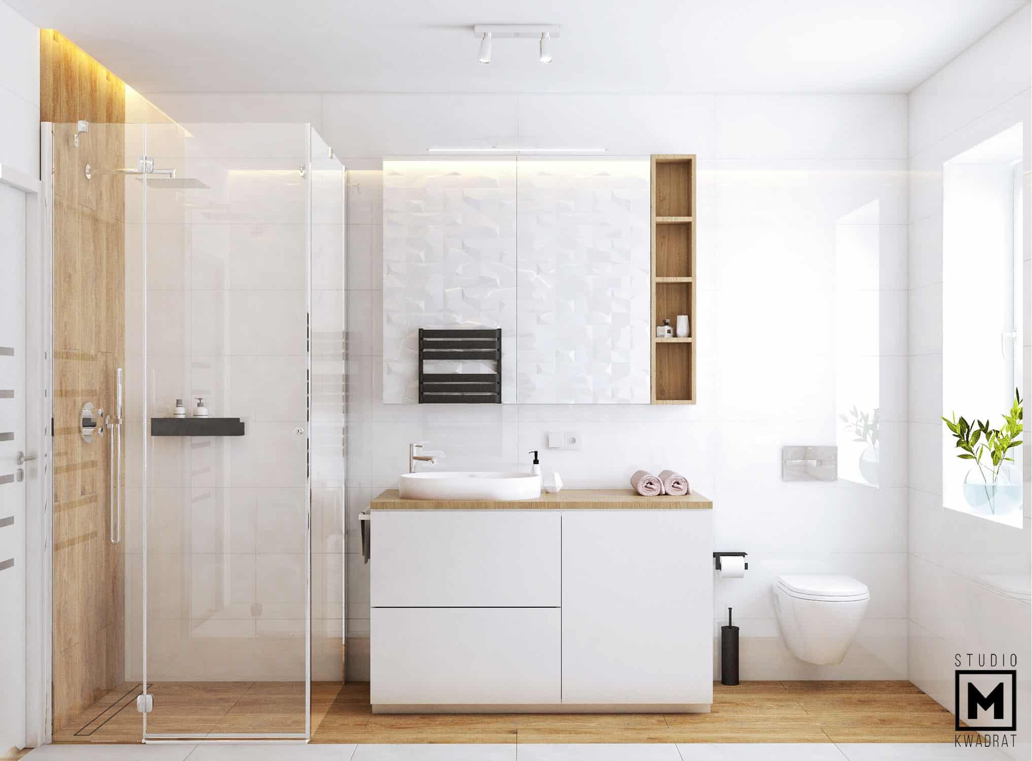 Płytki imitujące drewno w łazience, szklana kabina prysznicowa, listwa LED nad prysznicem, zabudowa projektowana na wymiar.