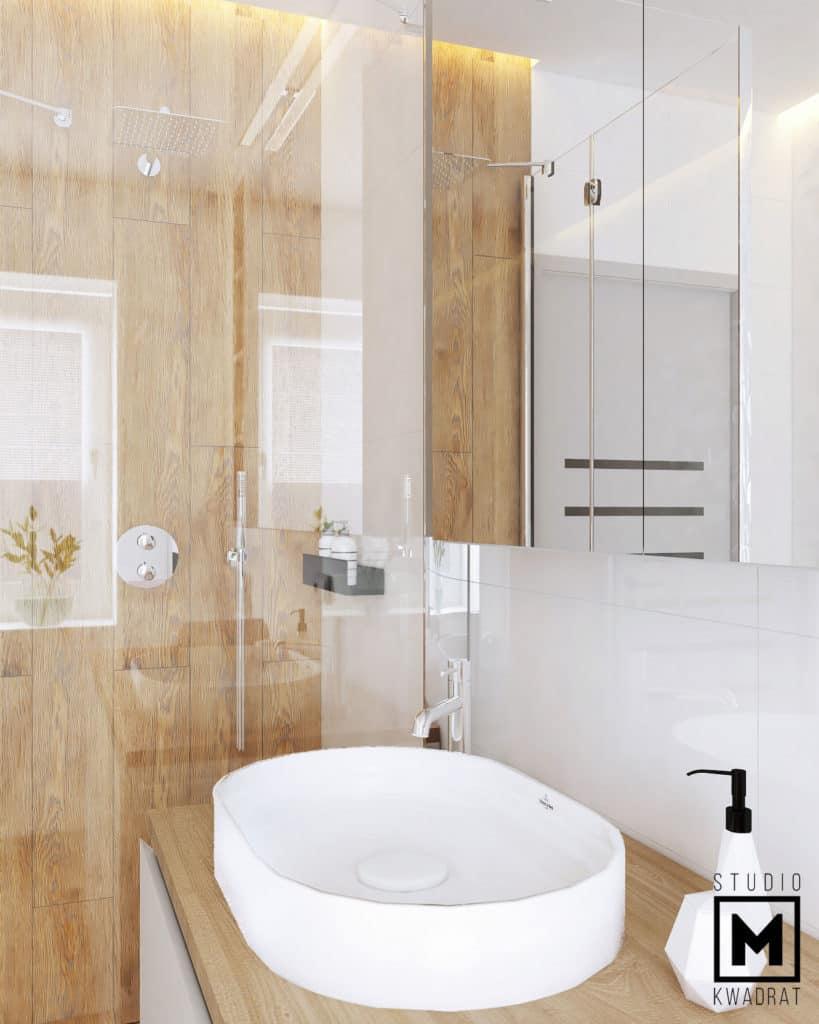 Biała owalna obła umywalka w projekcie eleganckiej łazienki.