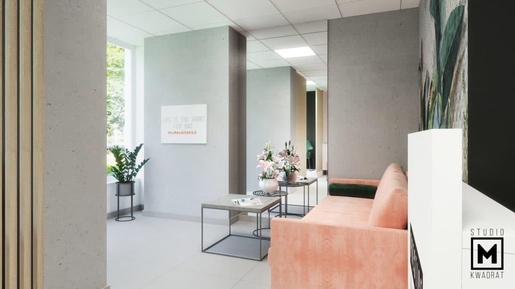 poczekalnia w salonie stylizacji paznokci pomarańczowa sofa beton architektoniczny lustra Poznań