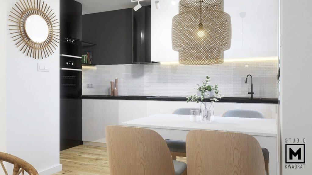 czarno biała zabudowa kuchenna, białe lakierowane meble kuchenne, czarny kamienny blat