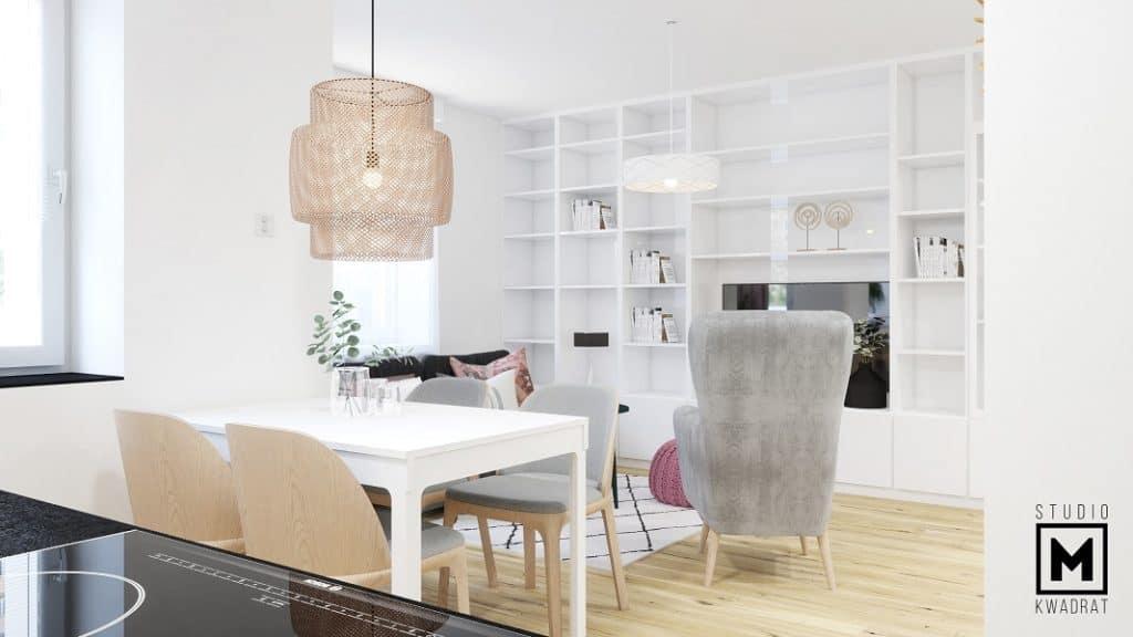 Lampa boho nad białym stole w projekcie wnętrza w Poznaniu.