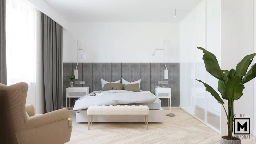 Przytulna minimalistyczna sypialnia z szarym zagłówkiem