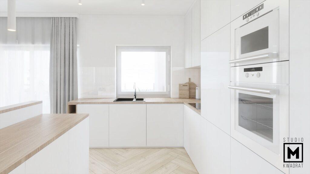 Jasna kuchnia pojemna minimalistyczna białe fronty frezowanie