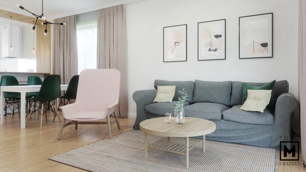 Przytulny jasny salon w pastelowych kolorach, szara sofa różowy fotel