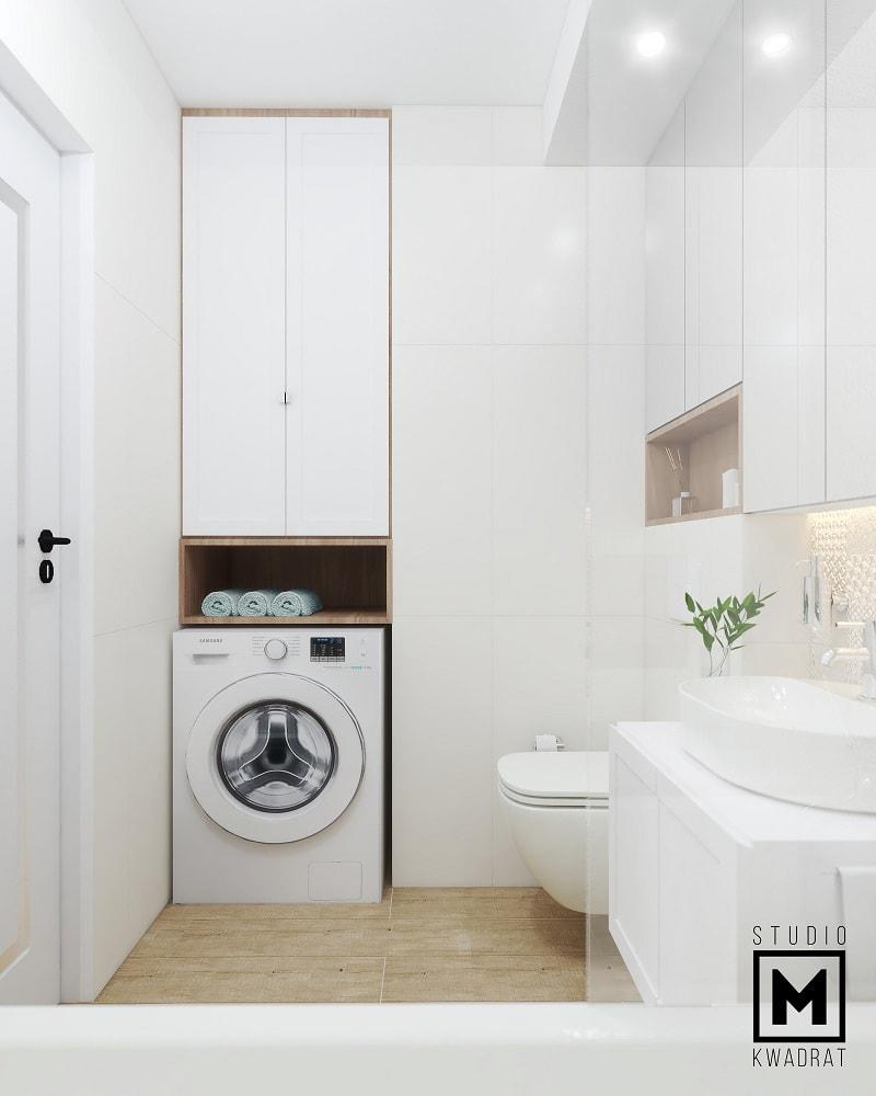 Pralka w eleganckiej łazience zabudowa wysoka szafa przechowywanie w łazience