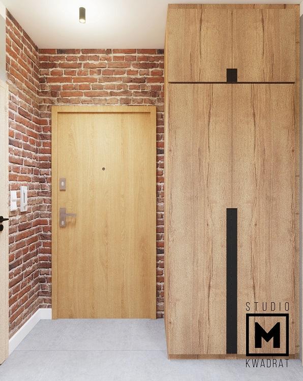 projekt przedpokoju z szafą na wymiar drewno i cegła