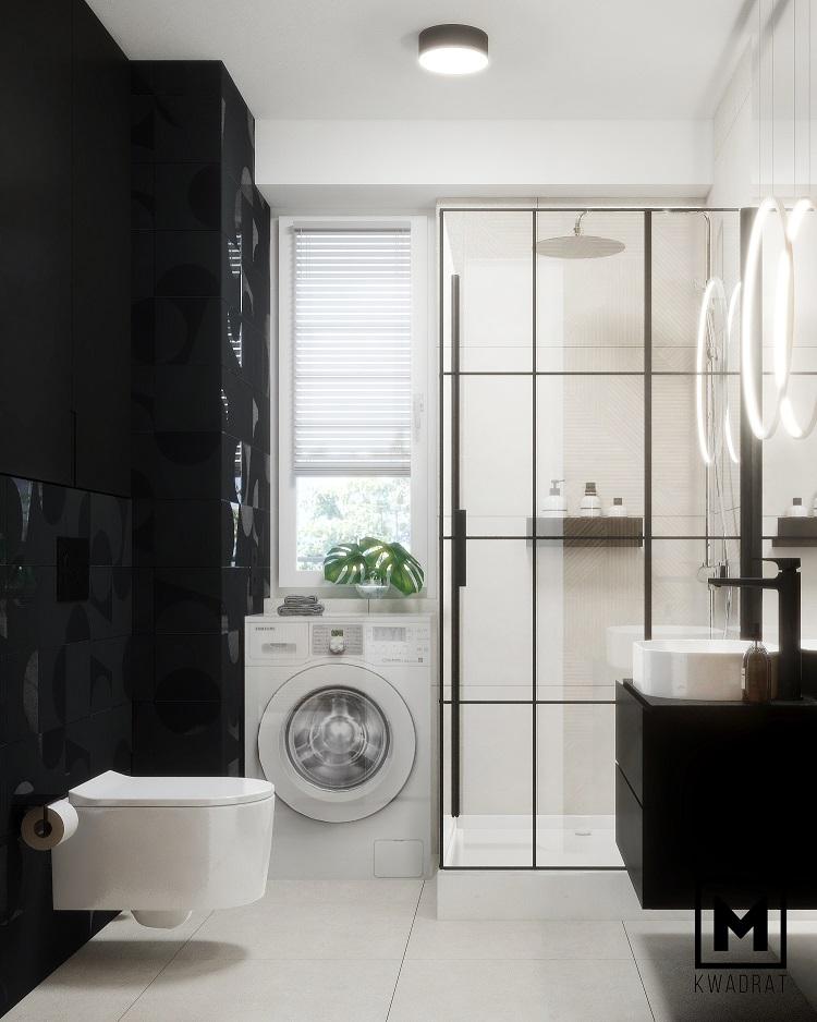 czarne geometryczne płytki w małej łazience