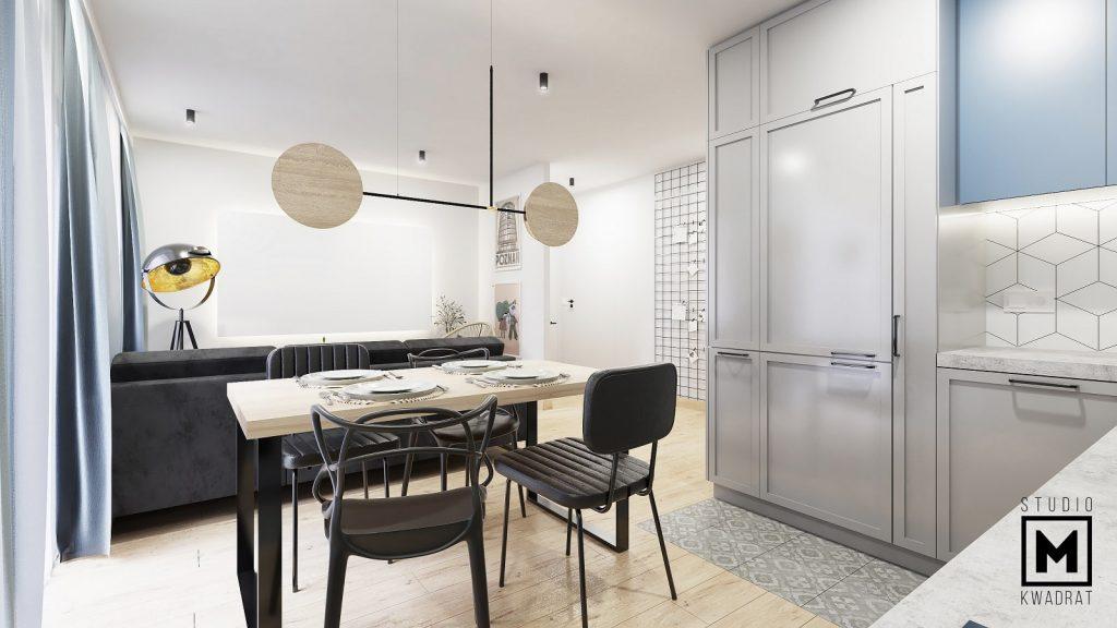 niebanalny salon z aneksem kuchennym z niebieskimi dodatkami