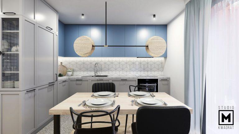 oryginalna kuchnia z niebieskimi frontami i awangardową lampą
