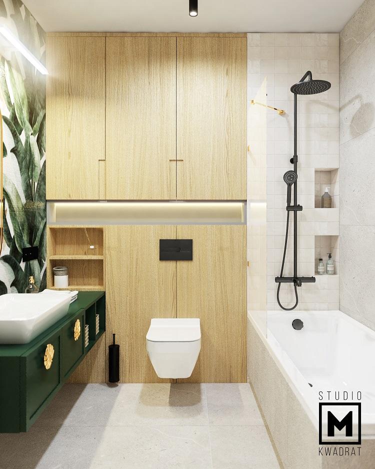 projekt jasnej łazienki z zielonymi meblami i złotymi dodatkami