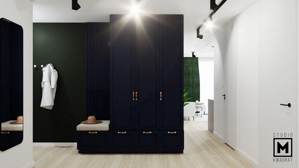 projekt przedpokoju z dużą granatową szafą ze żłobieniami zielone ściany