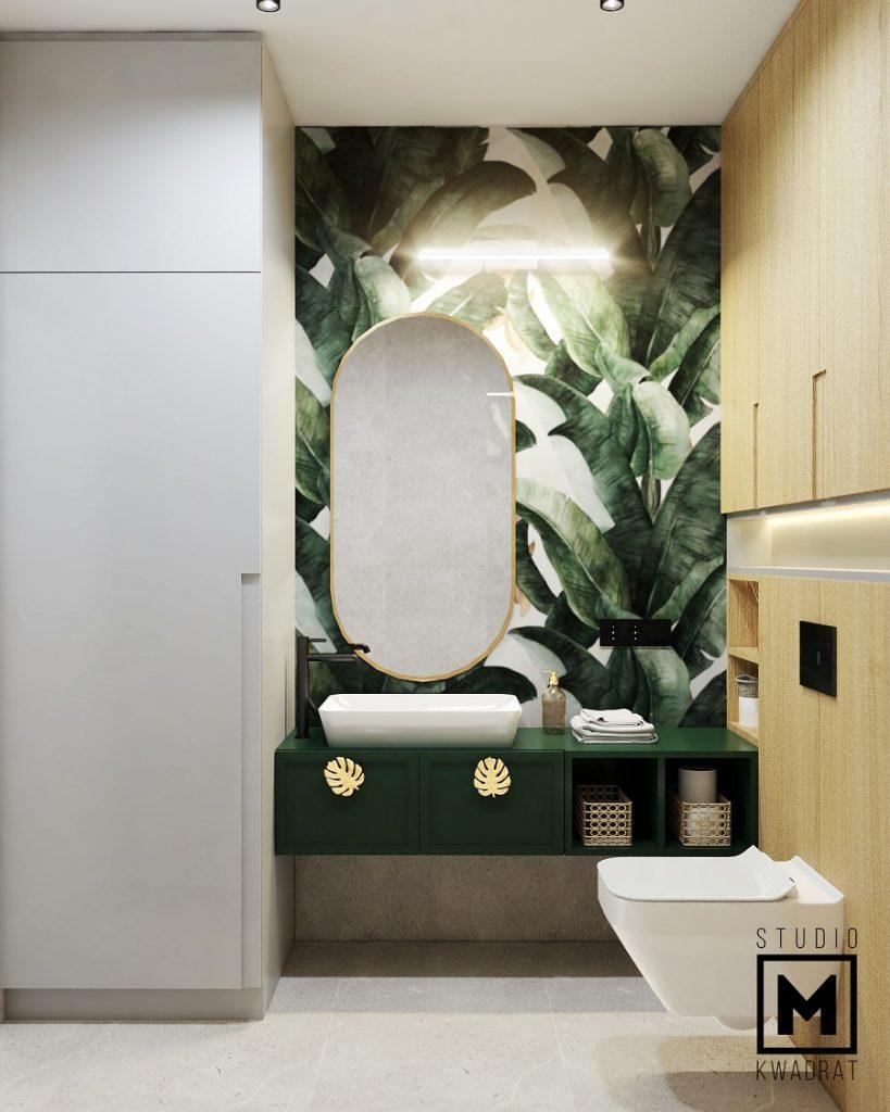 łazienka w bloku ze złotymi i zielonymi akcentami